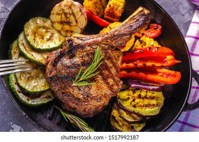 Juicy steak and grilled vegetables in a pan top view. Life style. Flat lay.