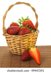 Juicy strawberries in a basket on isolated background