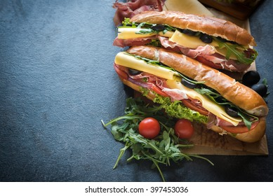 Juicy submarine sandwich and coke on the table,selective focus and copy space