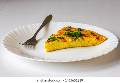 JUICY AND TASTY OMELET WITH TOMATOES AND CHEESE ON A PLATE WITH A FORK
