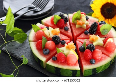Juicy watermelon pizza with summer fruits.Selective focus.