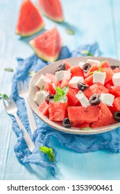 Juicy watermelon salad with feta cheese and black olives