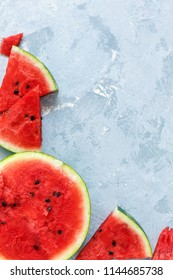 Juicy watermelon slices on a gray concrete background. Top view.
