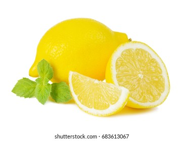 Juicy yellow cut lemon and green leaves of fresh mint isolated on white background