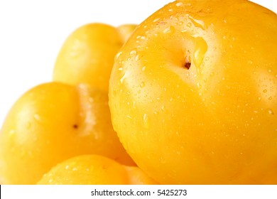 Juicy yellow plums isolated on white background
