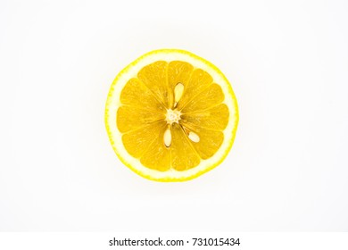 Juicy yellow slice of lemon on a white background isolated