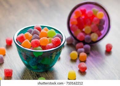 Jujube colored balls in a colorful glass bowl on a table