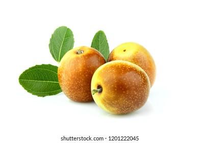 Jujube fruits (Ziziphus) with leaves close up on white background.
