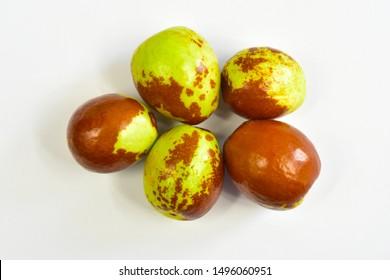 Jujube jojoba fresh oil fruits on white background