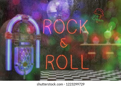 Jukebox in Bar with Neon Signs - Rock and Roll Rainy Window Image
