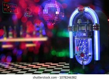 Jukebox in Ice Cream Parlor. Miniature set with neon composites.