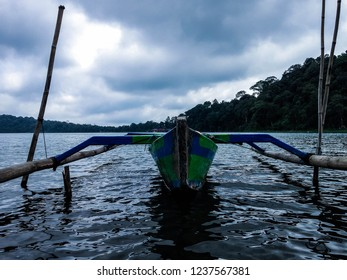 Jukung Traditional Paddle Canoe On The Lake Water Of Beratan At Bedugul, Tabanan, Bali, Indonesia