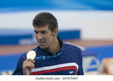 Jul 01 2009; Rome Italy; Michael Phelps (USA) shows his gold medal for mens 100m butterfly at the 13th Fina World Aquatics Championships held in the The Foro Italico Swimming Complex.
