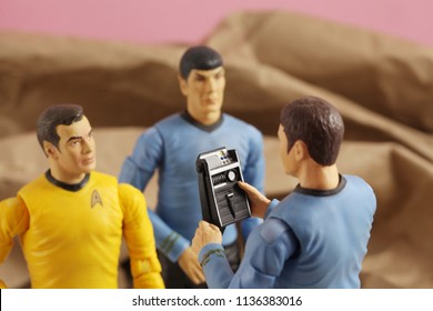 JUL 1 2018: Recreation of a scene from Star Trek original series where Captain Kirk, Mr. Spock and Doctor McCoy analyze data on a tricorder after beaming down to a planet - Art Asylum action figures
