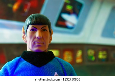 JUL 11 2018: Recreation of a scene from Star Trek the Original Series with a portrait of Mr. Spock at his science station on the bridge of the USS Enterprise - vintage Mego action figure