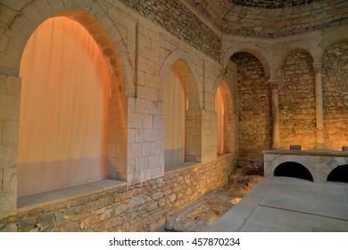 JUL 15, 2015: Romanic arches inside the Arabian baths in Girona, Catalonia, Spain