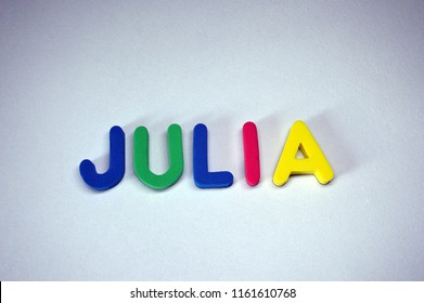 Julia - popular girls name from colorful letters on white background. Julia common female name.