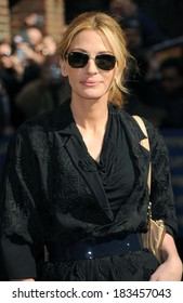 Julia Roberts, in Ray-Ban sunglasses and a Dries Van Noten coat, at talk show appearance for The Late Show with David Letterman, Ed Sullivan Theater, New York March 17, 2009