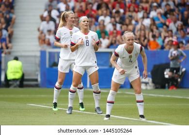 Julie Ertz of USA, Samantha Mewis of USA and Becky Sauerbrunn of USA during the FIFA Women's World Cup France 2019 Final football match USA vs Netherlands on 7 July 2019 Groupama Stadium Lyon France