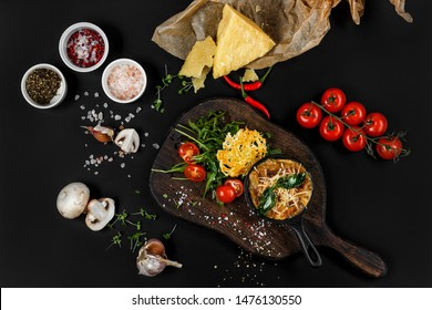 Julienne composition with vegetables and spices on black background