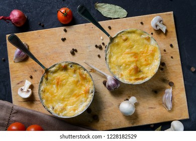 julienne with mushrooms on a wooden background