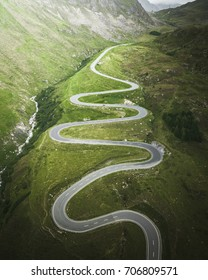 Julier Pass is the curvy mountain road located in the swiss alps. It connects the Engadin valley with the rest of Graubünden.