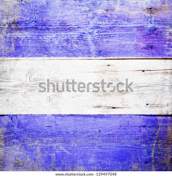 Juliet, international maritime signal flag painted on grungy wood plank background