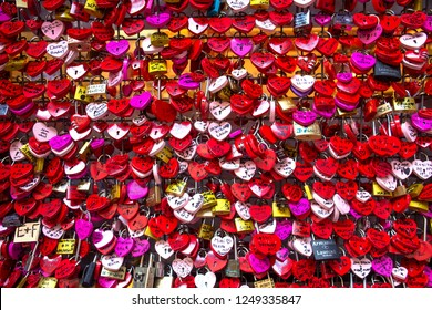 Juliet's House In Verona, Italy  - November 15, 2015 : Many colourful love padlocks at the wall of Juliet's house, Verona, Italy. romantic pattern