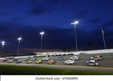July 01, 2017 - Daytona Beach, FL, USA: The NASCAR pack races through turn four during the Coke Zero 400 at Daytona International Speedway in Daytona Beach, FL.