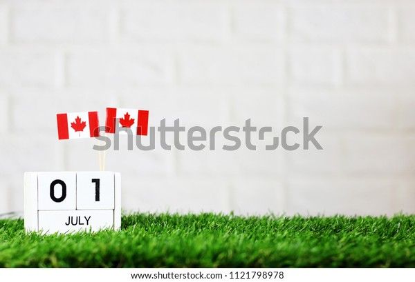 July 01 Wooden calendar and Canada Flag Concept Canada national day with space for your text