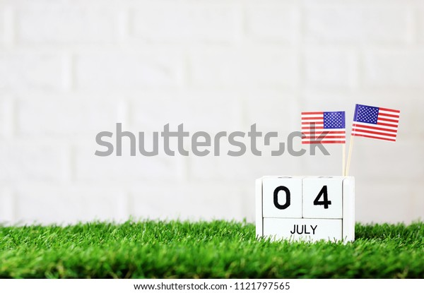 July 04 Wooden calendar and American Flag Concept American national day with space for your text