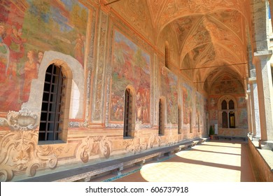 July 06, 2016: Old paintings decorate the cloister walls of Santa Chiara Monastery in Naples, southern Italy