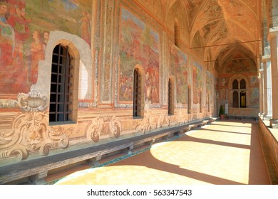 July 06, 2016: Religious paintings on the walls from the cloister of Santa Chiara Monastery in Naples, southern Italy