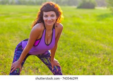July 06, 2017, Russia, Krasnoyarsk.Young beautiful fitness woman posing on nature background