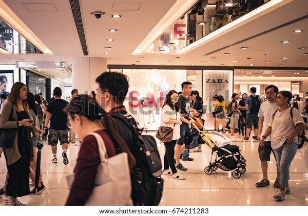 July 07, 2017, Sha Tin, Hong Kong : People walk through the shopping mall in Shatin New Town Plaza. New Town Plaza is a shopping mall in the town centre of Sha Tin in Hong Kong