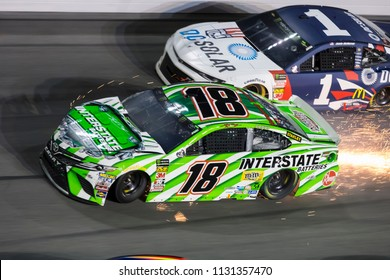 July 07, 2018 - Daytona Beach, Florida, USA: Kyle Busch (18) races through the field off turn four at the Coke Zero Sugar 400 at Daytona International Speedway in Daytona Beach, Florida.