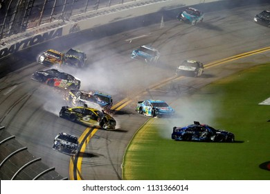 July 07, 2018 - Daytona Beach, Florida, USA: Darrell Wallace, Jr (43) and Clint Bowyer (14) spin in the tri-oval during the Coke Zero Sugar 400 at Daytona International Speedway