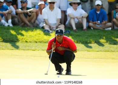 July 1, 2012; Bethesda, MD, USA; Tiger Woods reads the 14th green during the final round of the AT&T National at Congressional Country Club.