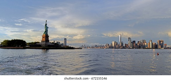 July 1, 2017, New York Harbor, Liberty Island, Lower Manhattan, New York City.  The Statue of Liberty looks over Lower Manhattan after a summer storm.