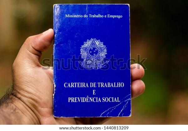 July 1, 2019, Brazil. Man holds his Brazilian document work and social security (Carteira de Trabalho e Previdencia Social).