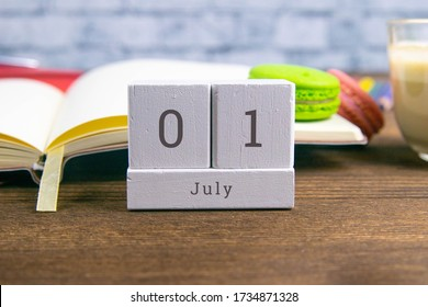 July 1 on the wooden calendar.The first day of the summer month, a calendar for the workplace. Summer.