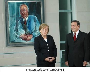 JULY 10, 2007 - BERLIN: Chancellor Angela Merkel with her predecessor, Gerhard Schroeder in front of a portrait of Helmut Kohl in the Chancelry in Berlin.