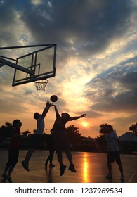 July 10, 2015 Korea, Seoul, Hangang Park Sunset photographed a great afternoon, people playing basketball.