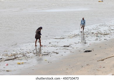 July 10, 2016 : People clean up garbage and Garbage truck collecting trash at Bangsaen Beach in The Morning, Big Cleaning Day. Chon Buri, Thailand
