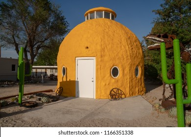 JULY 10 2018 - CARTAGO, CALIFORNIA: The landmark roadside attraction Big Yellow Lome Dome House sits abandoned along US Highway 395 in the Eastern Sierra Nevada mountains