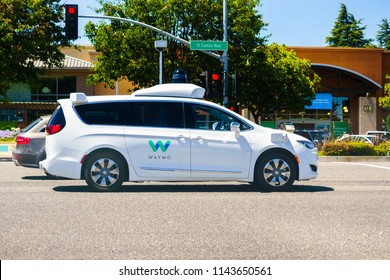July 10, 2018 Mountain View / CA / USA - Waymo self driving car cruising on a street in south San Francisco bay area, Silicon Valley