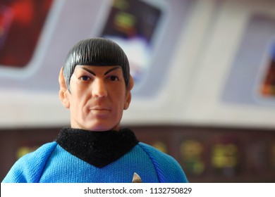JULY 11 2018: Recreation of a scene from Star Trek the Original Series with a portrait of Mr. Spock at his science station on the bridge of the USS Enterprise - vintage Mego action figure