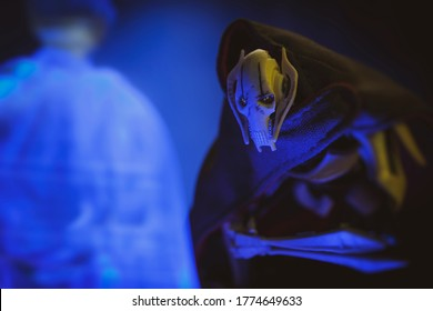 JULY 11 2020: Scene from Star Wars The Clone Wars with Separatist General Grievous kneeling to a hologram of Darth Sidious  / Palpatine - Hasbro action figure
