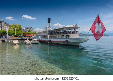 July 12, 2018. Cruiser ship with red swiss flag on Lucerne lake, Switzerland.