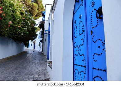 July 12 2019: Sidi Bou Said, Tunisia: A traditional door in the center of the authentic village of Sidi Bo Said, also known as the blue city. Tunisia